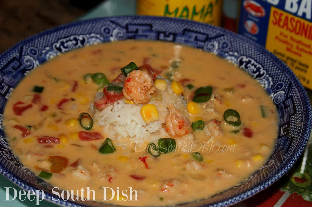 A quicker, off-season version of Crawfish Bisque made using frozen pureed and whole Louisiana crawfish tails, commercial seafood or chicken stock, the trinity (onion, bell pepper and celery), tomatoes, corn and Cajun seasonings.